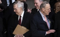 Mitch McConnell and Chuck Schumer stand back-to-back.