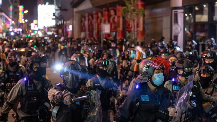 Riot police respond to demonstrators in Hong Kong protesting against a plan to use new public housing as a possible coronavirus quarantine facility.