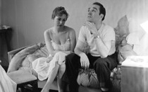 A black-and-white photo of a couple looking unhappy