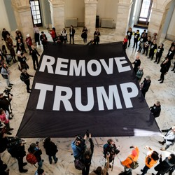 Protesters call for President Trump to be removed from office.