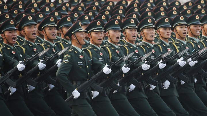 Chinese soldiers rehearse for a military parade
