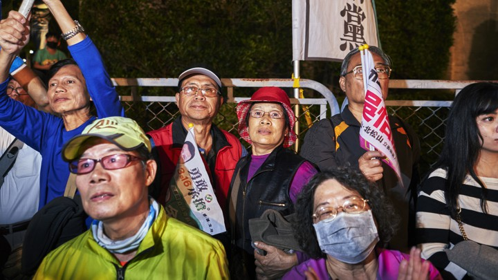 People wait for election results in Taiwan.
