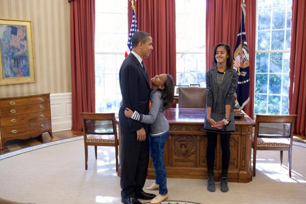president barack obama talks with daughters sasha and malia in the