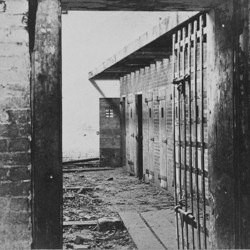 Interior view of a slave pen, showing the doors of cells where the slaves were held before being sold