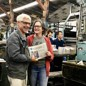 Editor Ed Miller and publisher Teresa Parker with Vol. 1 No. 1 of The Provincetown Independent as it comes off the press on Sept. 6