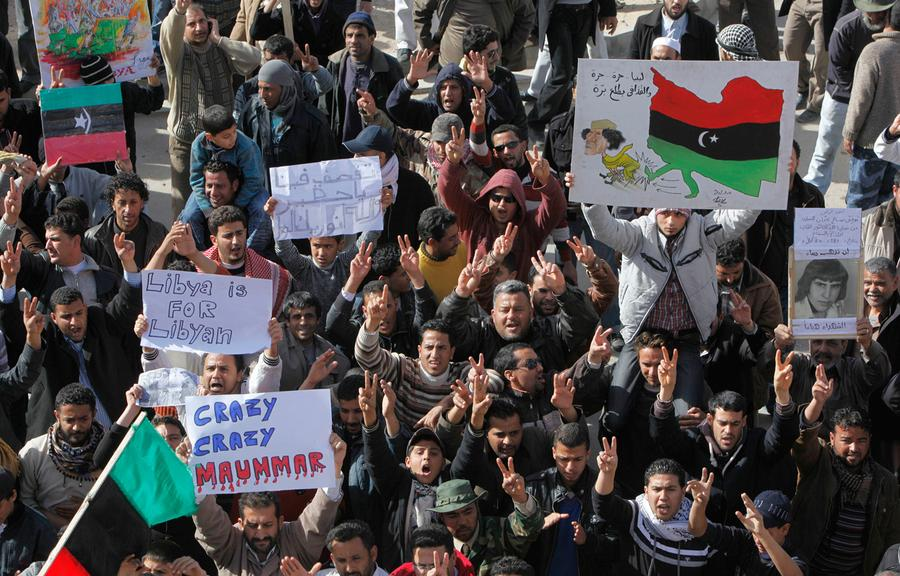 A bloody week in libya the atlantic libyan protesters hold signs and shout slogans against libyan leader muammar qaddafi during a demonstration in tobruk libya on wednesday february 23 sciox Choice Image