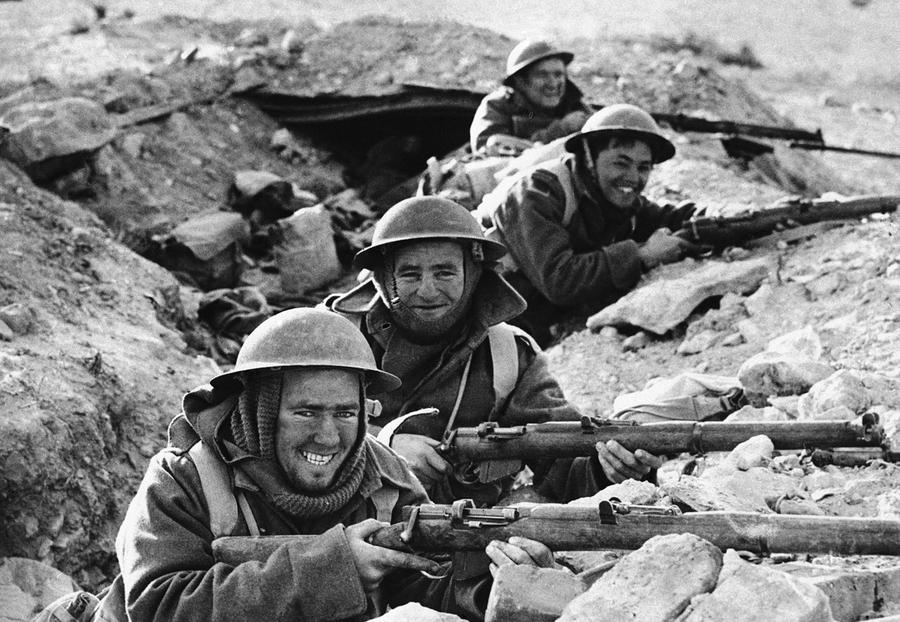 British infantrymen in position in a shallow trench near bardia a