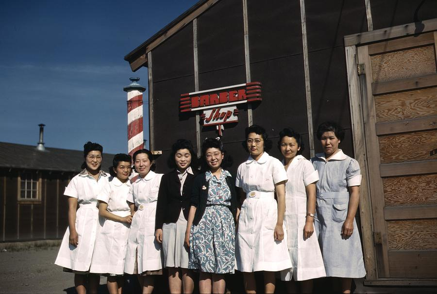 68023ad46 Women pose outside the barber shop in the Tule Lake Relocation Center