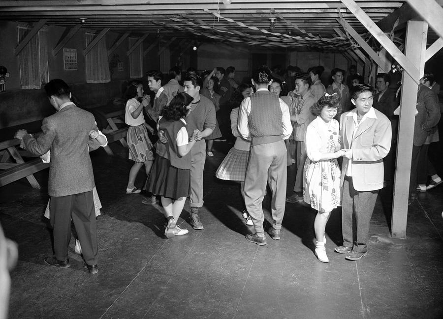 world war ii internment of ese americans the atlantic  ese americans removed from their los angeles homes attend a dance at the government s camp at manzanar california on 23 1942
