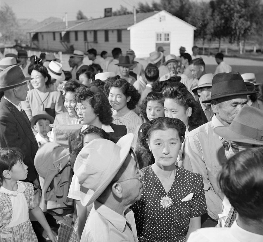 35f8d2b06 Evacuees from Arizona s Poston War Relocation Center stand in line before  the departure station where they received ration books and bus tickets home  in ...