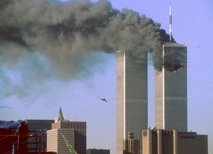 the day of the attacks the atlantic flies low toward the south tower of the world trade center shortly before slamming into the structure the north tower burns after an earlier attack by