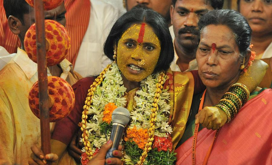 Indian Devotee Swarnaltha (center), Who Undertook A Vow Of Chastity And  Devoted Her Life To The Hindu Goddess Mahankali, Answers Questions While  Allegedly ...