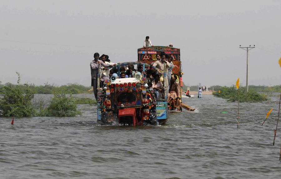 new devastating floods the atlantic i flood affected people evacuate the flooded area of kaloi district in tharparkar by truck on 17 2011 the united nation s children