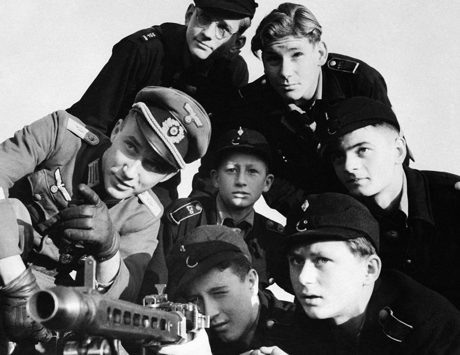World War Ii The Fall Of Nazi Germany  The Atlantic A Group Of Hitler Youth Receive Instruction In The Use Of A Machinegun  Somewhere In Germany On December    Essays For High School Students To Read also Essay Writing Format For High School Students  Reflection Paper Essay