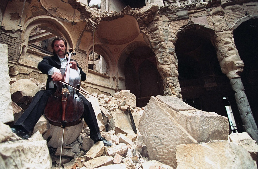During the Bosnian War, cellist Vedran Smailovic plays Strauss inside the bombed-out National Library in Sarajevo, on September 12, 1992. #