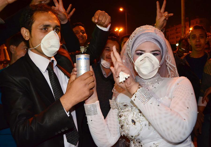 the masks we wear the atlantic revolutionary activist mohammed magdy and his bride wear masks against tear gas and jointly hold a used tear gas container celebrating their wedding in