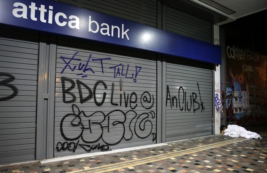 Homeless people sleep outside a bank in Athens, on May 26, 2013. #