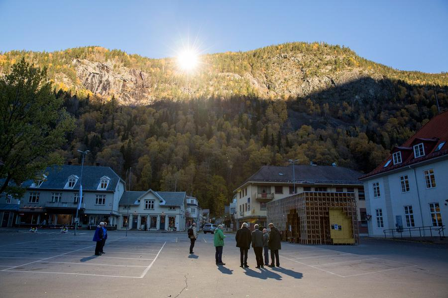 In The Town Of Rjukan Norway People Gather Front Hall Where Sunlight Is Reflected By Giant Mirrors Top Erected On Mountainside