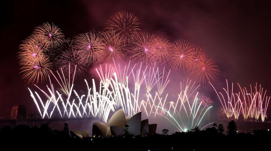 Happy new year 2014 the atlantic fireworks explode over the harbour bridge and the opera house during new years eve celebrations in sydney australia on january 1 2014 voltagebd Image collections