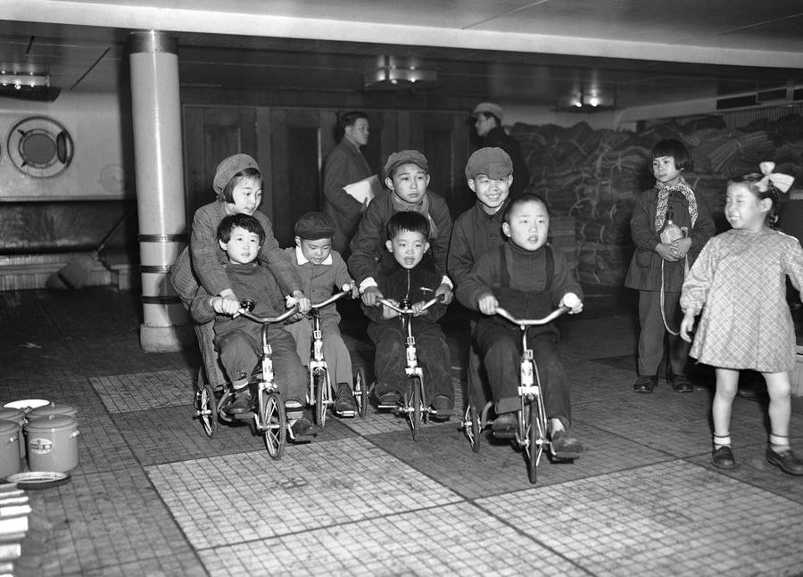 family watching tv 1950s. children of repatriated families scoot around the deck koan maru as their parents prepare to disembark at maizuru bay, japan, on march 24, 1953. family watching tv 1950s k