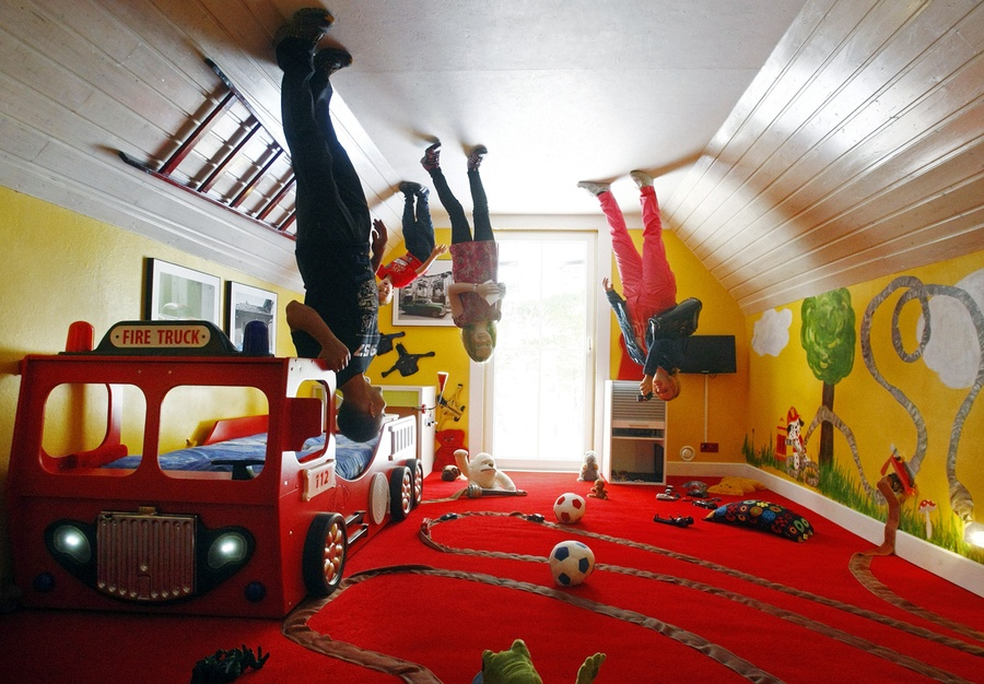 People stand inside a child's room in the upside down house in Terfens,  Austria, on May 5, 2012. [Click image to flip view - javascript required] #