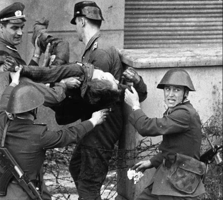 24bd791c406 Dying Peter Fechter is carried away by East German border guards who shot  him down when he tried to flee to the west in this August 17