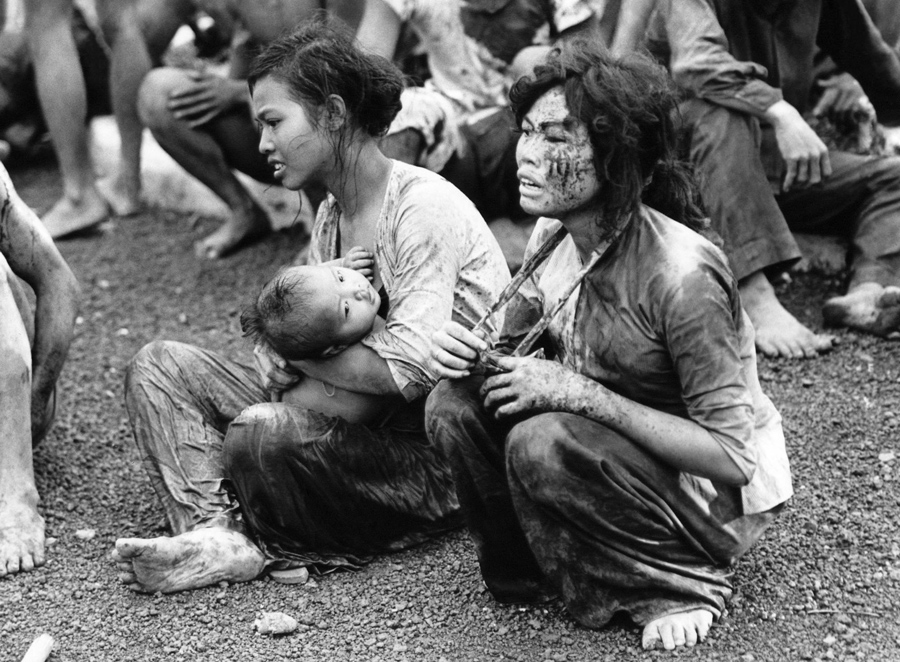 Wounded And Shocked Civilian Survivors Of Dong Xoai Crawl Out A Fort Bunker On June 6 1965 Where They Survived The Murderous Ground Fighting Air