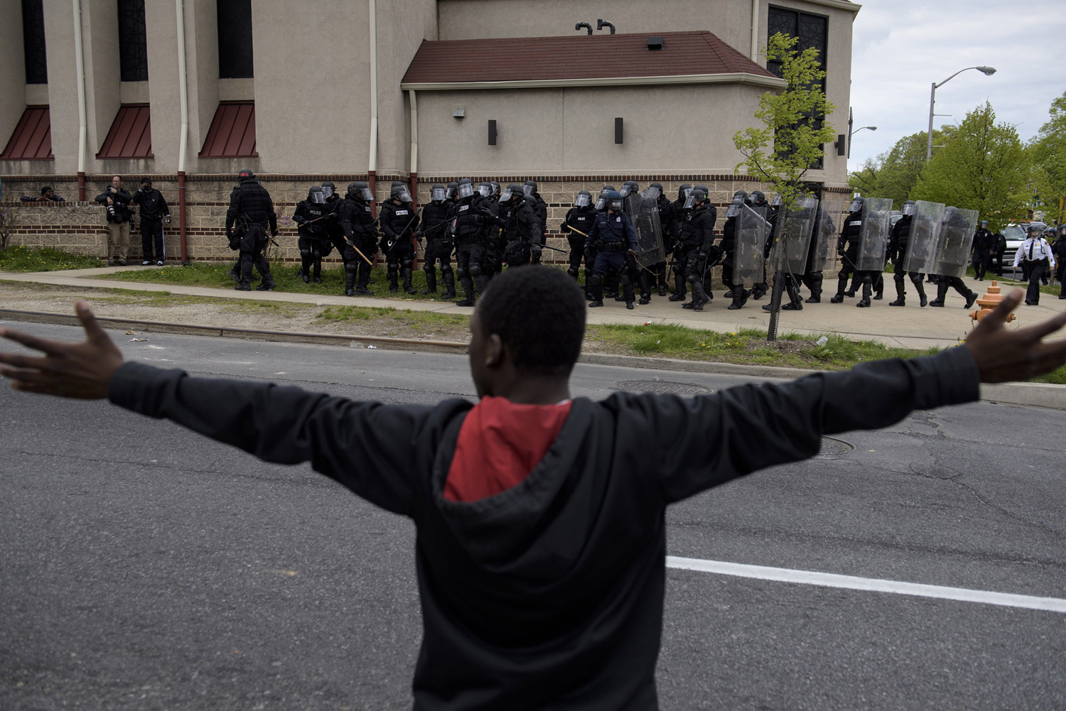Baltimore police officers in riot gear push protestors back along - Baltimore Police Officers In Riot Gear Push Protestors Back Along 45