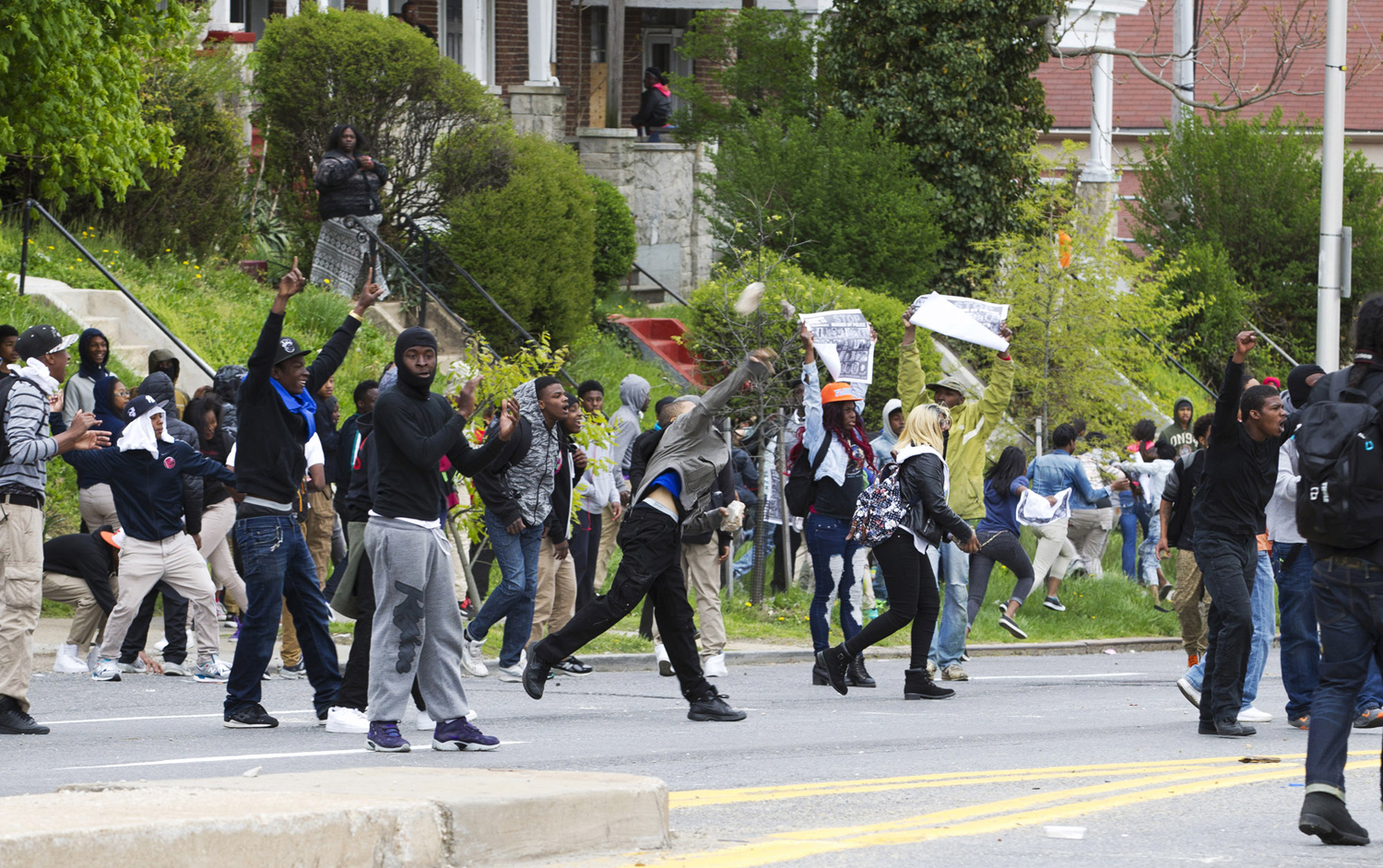 Baltimore police officers in riot gear push protestors back along - Baltimore Police Officers In Riot Gear Push Protestors Back Along 3