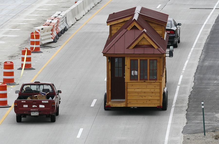 a tumbleweed brand cypress 24 model tiny house is towed down the highway near boulder colorado on august 4 2014 the tiny house movement started some boulder tiny house front