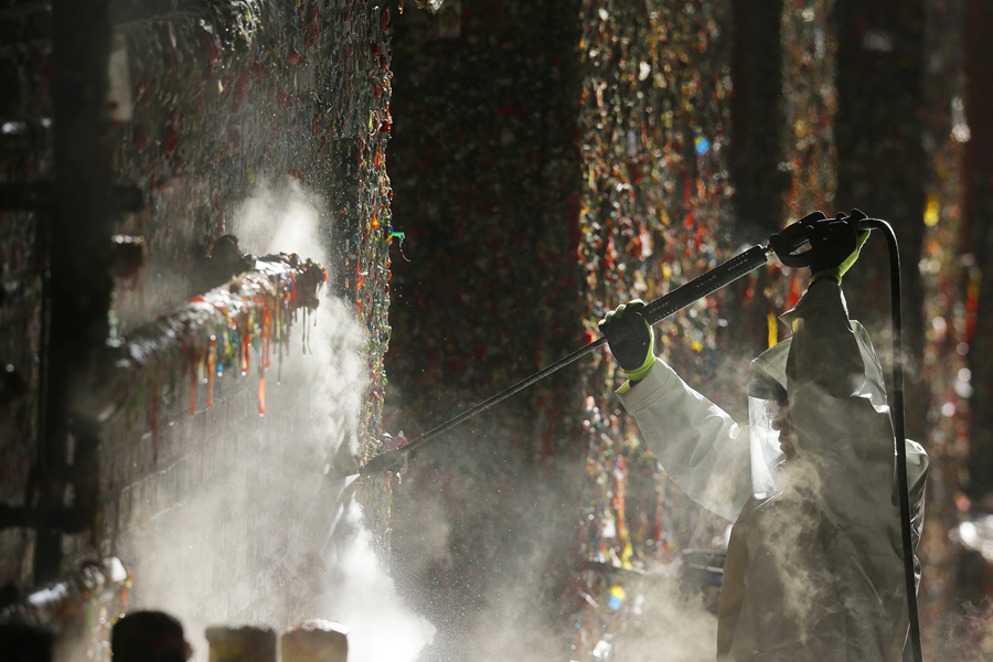 A Worker Uses A High Temperature Pressure Washer To Clean Layers Of Gum  From The Gum Wall, On November 10, 2015. #