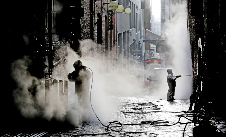 Workers Use Powerful Steam Cleaners To Clean Decades Of Gum Off The Famous  Gum Wall In Seattle On November 10, 2015. #