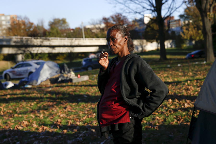 Lovenia Evans who is pregnant smokes a cigarette by her tent between the Watergate and Whitehurst Freeway in Washington D.C. on November 16 2015. & Americau0027s Tent Cities for the Homeless - The Atlantic