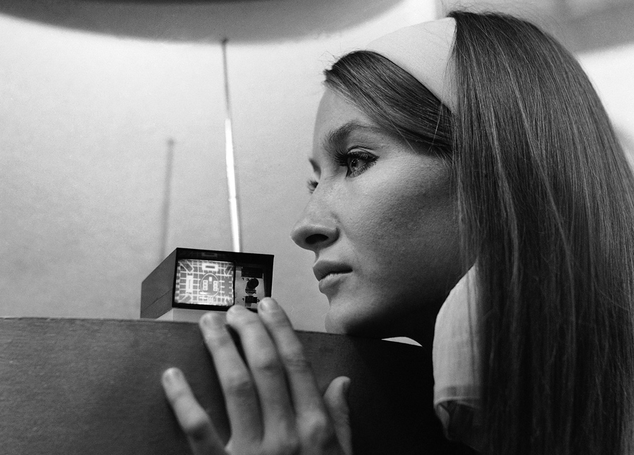 A model looks at the Sinclair Microvision set  a pocket size television set designed by Clive Sinclair that can go anywhere and claims to be the world     s     The Atlantic