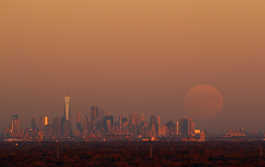 a supermoon rises at sunset over lower manhattan in new york city on november 13 2017 as seen from watchung jersey