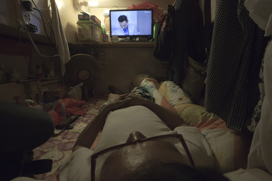 Simon Wong An Unemployed Man Watches Tv In His Coffin Home Hong Kong On May 4 2017
