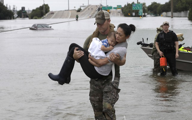 Image result for flood volunteers hug victims