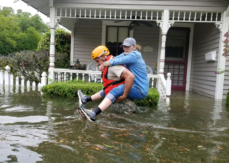 A Texas National Guard Solr Carries Woman On His Back As They Conduct Rescue Operations In Flooded Areas Around Houston August 27 2017