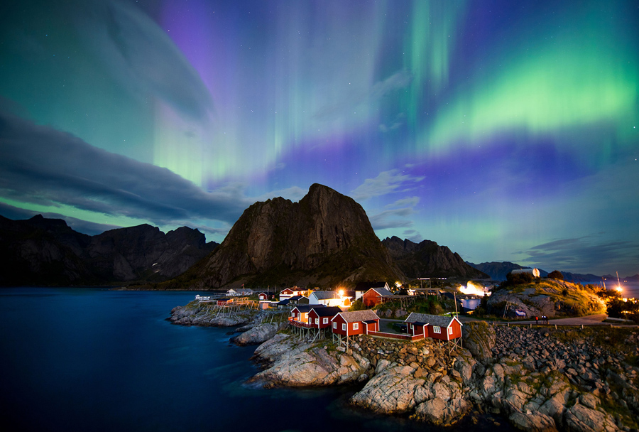 The Northern Lights Illuminate Sky Over Reinfjorden In Reine On Norway S Lofoten Islands September 8 2017