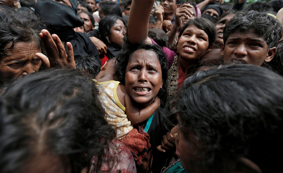 hundreds of women and children begging for help during the Rohingya crisis 2017