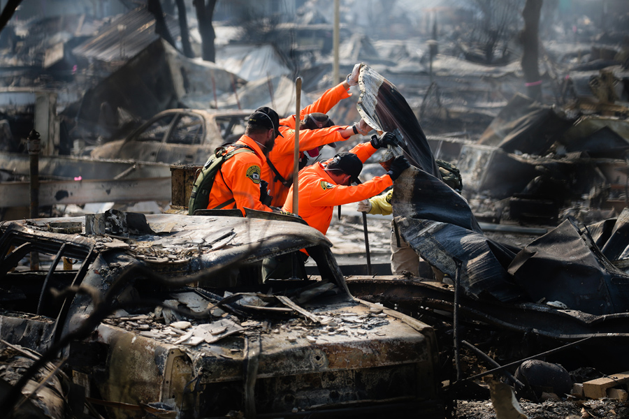 Search And Rescue Personnel Look For Human Remains In The Journeys End Mobile Home Park Following Damage Caused By Tubbs Fire On October 13 2017