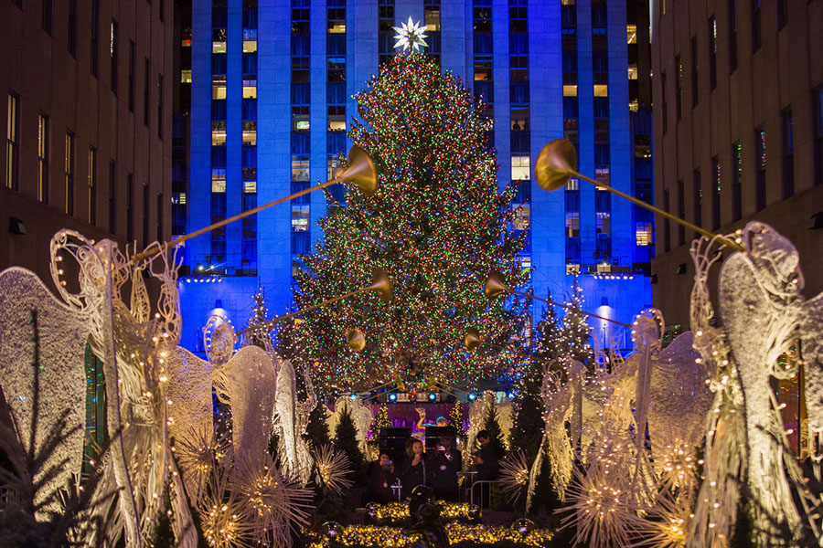 the rockefeller center christmas tree stands lit as people take photos of it and the holiday decorations at rockefeller center during the 85th annual - Rockefeller Christmas Show