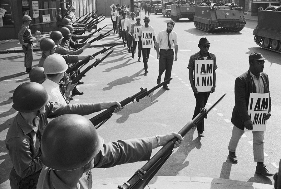 Guard Troops Block Off Beale Street In Memphis Tennessee As Civil Rights Marchers Wearing Placards Reading