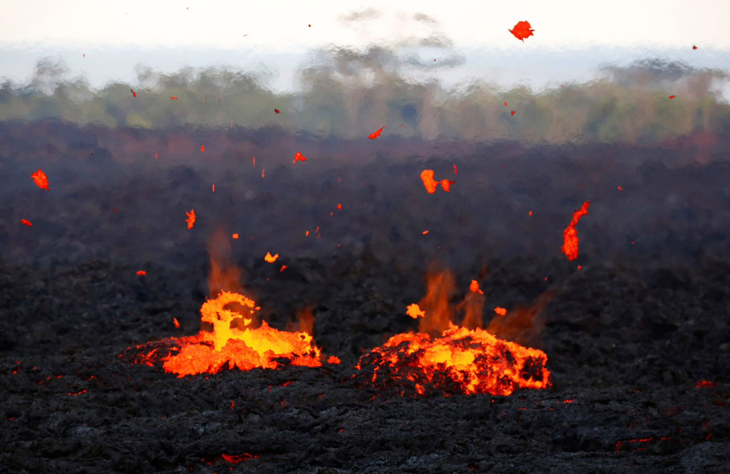 lava erupts from a fissure by Terray Sylvester