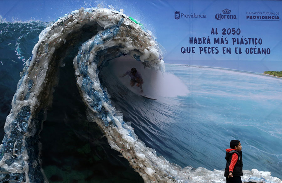 world environment day  beat plastic pollution  the atlantic a billboard portrait of a man surfing a wave made of plastic bags and  bottles created to denounce ocean pollution is pictured in santiago  chile