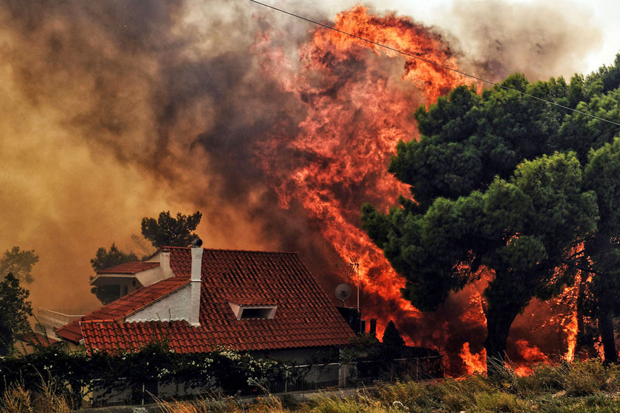 photos of the devastating wildfires outside athens greece the