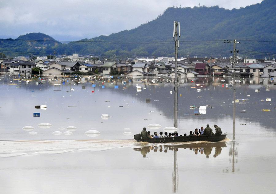 photos death toll reaches 200 in devastating japan floods the atlantic. Black Bedroom Furniture Sets. Home Design Ideas