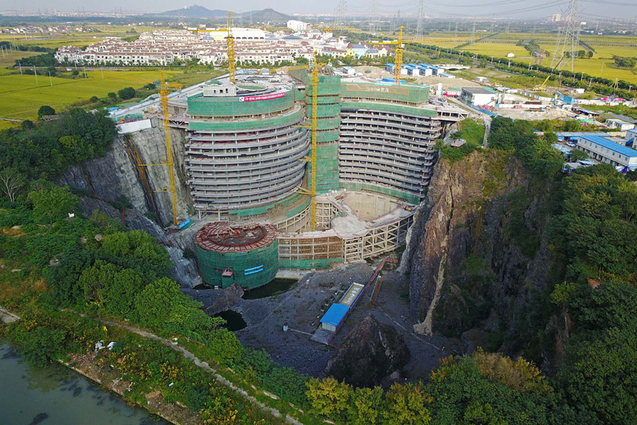 The construction site of a hotel being built inside an abandoned quarry in  Songjiang District in Shanghai on October 26, 2017. Work is still under way  to ...