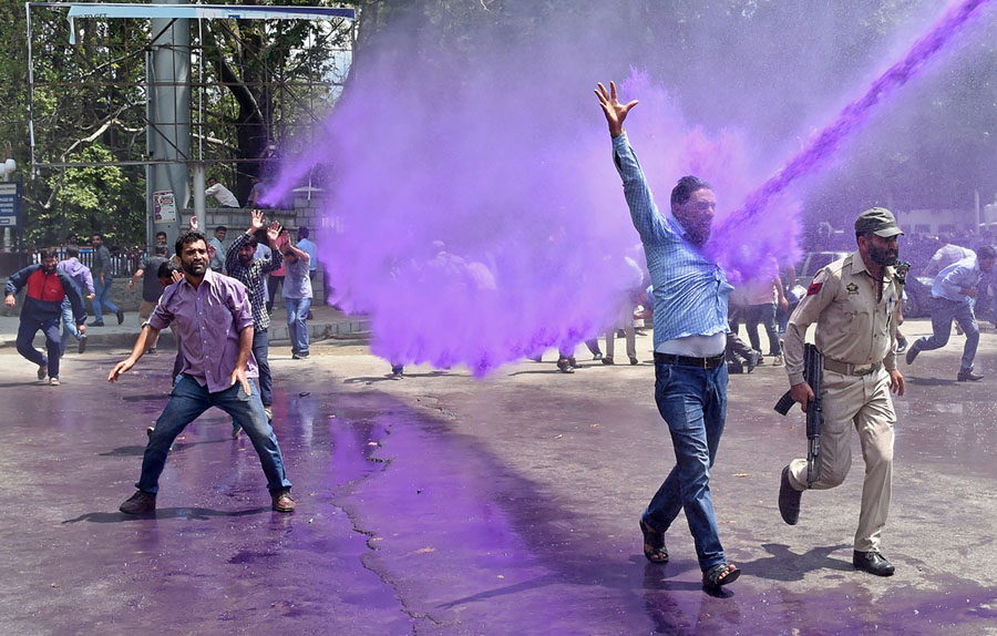 Kashmiri Government Teachers Shout Anti Government Slogans As Indian Police  Spray Purple Colored Water During A Protest In Srinagar On August 9, 2018.