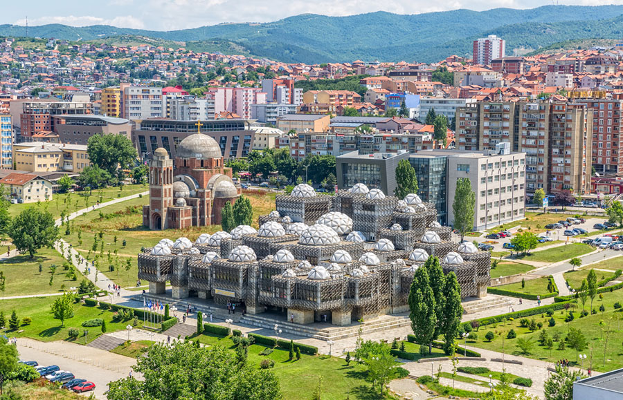 An aerial view of the National Library of Kosovo in the capital city of Pristina on July 1, 2015. # OPIS Zagreb / Shutterstock